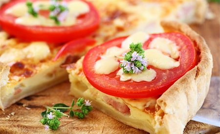 Tradition French bacon quiche with onion, tomato and cheese Stock Photo - Budget Royalty-Free & Subscription, Code: 400-05382934