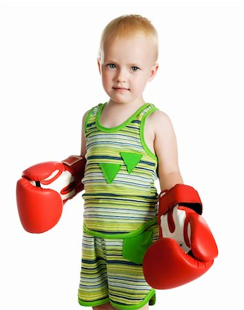 little boy in red boxing gloves on white background Stock Photo - Budget Royalty-Free & Subscription, Code: 400-05665492