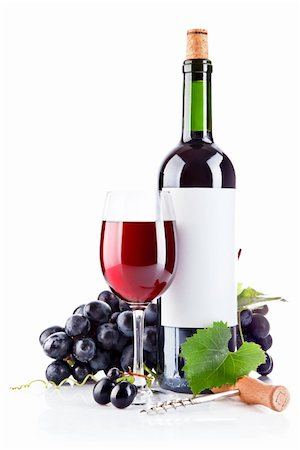 red wine in glass with grapes isolated on white background Stock Photo - Budget Royalty-Free & Subscription, Code: 400-05665603