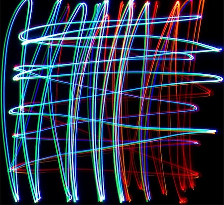 Chaotic colorful lights on  black background Stock Photo - Budget Royalty-Free & Subscription, Code: 400-05663304