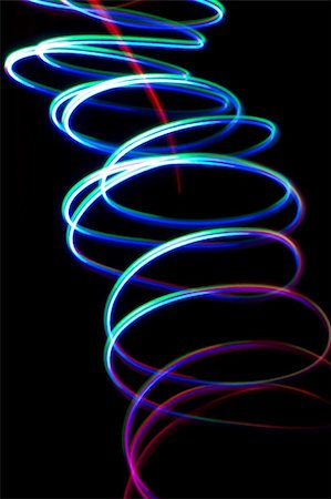 Chaotic colorful lights on  black background Stock Photo - Budget Royalty-Free & Subscription, Code: 400-05663307