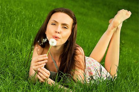 Girl with dandelion on green field Stock Photo - Budget Royalty-Free & Subscription, Code: 400-05663979