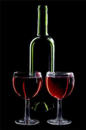 Color photo of a two glass bottles with a black background Stock Photo - Budget Royalty-Free & Subscription, Code: 400-05676795