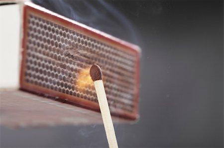 A Match ignited by rubbing the match head against a match box. Stock Photo - Budget Royalty-Free & Subscription, Code: 400-05676973