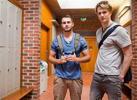Handsome students posing in a corridor Stock Photo - Budget Royalty-Free & Subscription, Code: 400-05677889