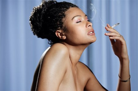 Beautiful sensual and naked woman enjoying a cigarette on blue baggrund Stock Photo - Budget Royalty-Free & Subscription, Code: 400-05678194