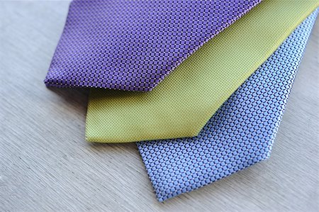 Image of 3 ties on white wood background Stock Photo - Budget Royalty-Free & Subscription, Code: 400-05678503