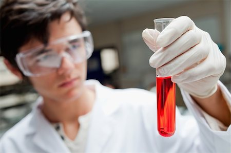 plasma - Young scientist holding a test tube in laboratory Stock Photo - Budget Royalty-Free & Subscription, Code: 400-05670010
