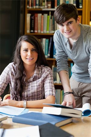 Portrait of smiling students in a library Stock Photo - Budget Royalty-Free & Subscription, Code: 400-05670117