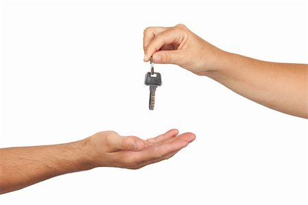 finger holding a key - Hand giving a key isolated on white background Stock Photo - Budget Royalty-Free & Subscription, Code: 400-05670212