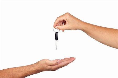 finger holding a key - Hand giving car keys isolated on white background Stock Photo - Budget Royalty-Free & Subscription, Code: 400-05670213