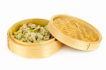dumplings steamer - Bamboo steamer with cooked dumplings isolated on white Stock Photo - Budget Royalty-Free & Subscription, Code: 400-05671197