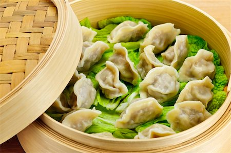 dumplings steamer - Closeup of bamboo steamer with cooked dumplings Stock Photo - Budget Royalty-Free & Subscription, Code: 400-05671198