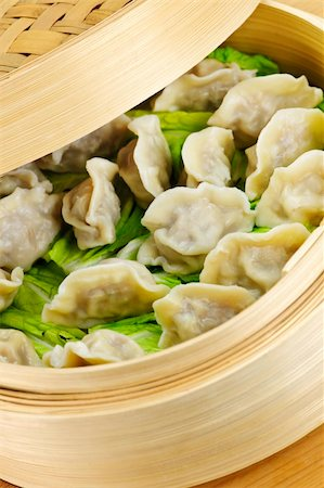 dumplings steamer - Closeup of bamboo steamer with cooked dumplings Stock Photo - Budget Royalty-Free & Subscription, Code: 400-05671199
