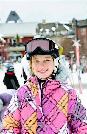 Portrait of happy teenage girl in ski helmet and goggles at winter resort Stock Photo - Budget Royalty-Free & Subscription, Code: 400-05671227