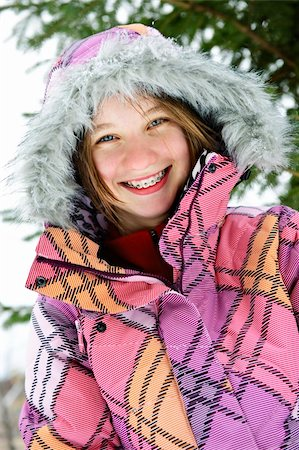 Portrait of happy teenage girl in winter ski coat with fur hood Stock Photo - Budget Royalty-Free & Subscription, Code: 400-05671230
