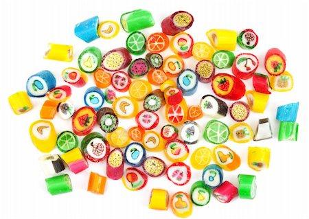 eat lollipop bubblegum - Varicoloured sweet lollipop is spilt on white background Stock Photo - Budget Royalty-Free & Subscription, Code: 400-05672138