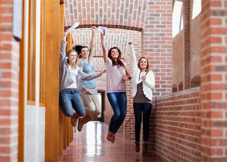 Students jumping with their results in a corridor Stock Photo - Budget Royalty-Free & Subscription, Code: 400-05672219