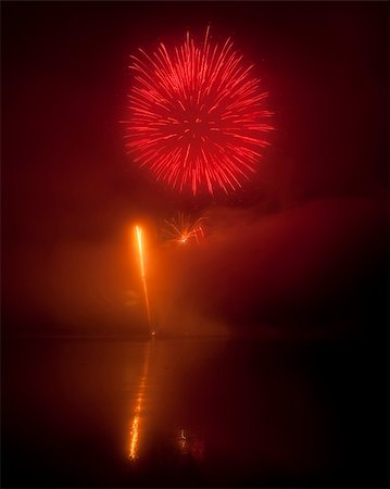 Colorful fireworks on black sky background with water reflections Stock Photo - Budget Royalty-Free & Subscription, Code: 400-05672411