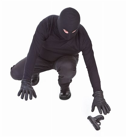 bandit is trying to recover his weapon on white background Stock Photo - Budget Royalty-Free & Subscription, Code: 400-05672518