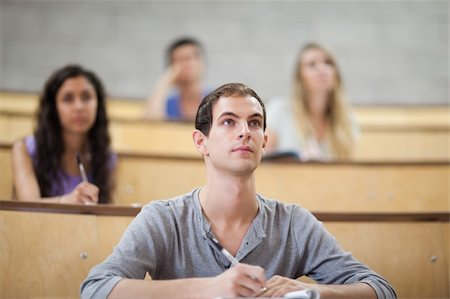 Students listening during a lecture in an amphitheater Stock Photo - Budget Royalty-Free & Subscription, Code: 400-05684319
