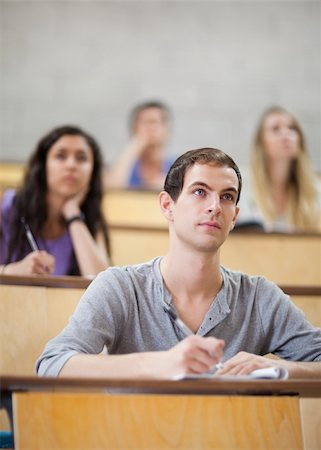 Students listening during a lecture in an amphitheater Stock Photo - Budget Royalty-Free & Subscription, Code: 400-05684321