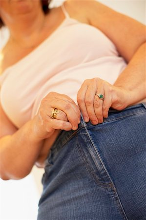 Overweight Woman Trying To Fasten Trousers Stock Photo - Budget Royalty-Free & Subscription, Code: 400-05686625