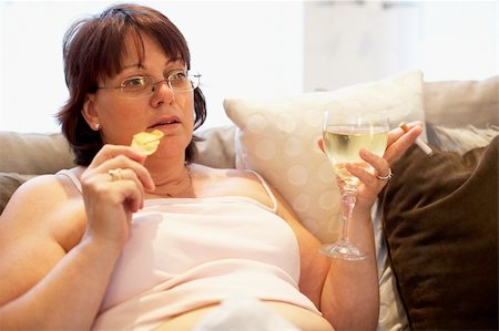 Overweight Woman Relaxing On Sofa Stock Photo - Budget Royalty-Free & Subscription, Code: 400-05686620