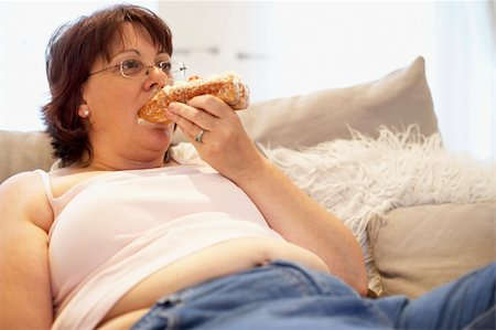 Overweight Woman Relaxing On Sofa Stock Photo - Budget Royalty-Free & Subscription, Code: 400-05686621