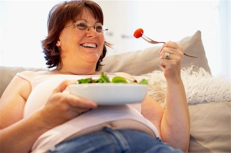Overweight Woman Relaxing On Sofa Stock Photo - Budget Royalty-Free & Subscription, Code: 400-05686623