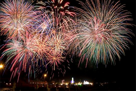 Panoramic view of fireworks over a fair in the night Stock Photo - Budget Royalty-Free & Subscription, Code: 400-05689138