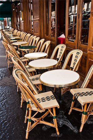 Street view of a Cafe terrace with empty tables and chairs,paris France Stock Photo - Budget Royalty-Free & Subscription, Code: 400-05680438