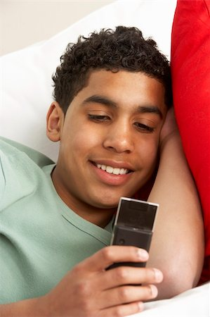 pre-teen boy models - Young Boy Reading Text Message Stock Photo - Budget Royalty-Free & Subscription, Code: 400-05697178