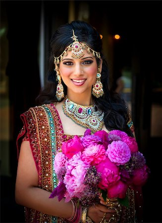 Image of a smiling Indian bride holding bouquet Stock Photo - Budget Royalty-Free & Subscription, Code: 400-05697308