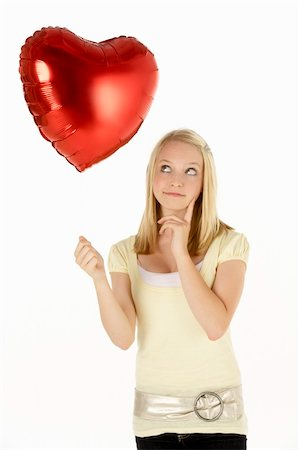 Teenage Girl Holding Heart-Shaped Balloon Stock Photo - Budget Royalty-Free & Subscription, Code: 400-05697569