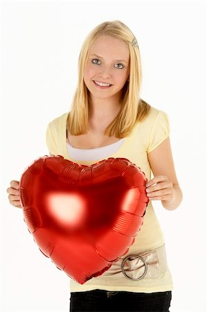 Teenage Girl Holding Heart-Shaped Balloon Stock Photo - Budget Royalty-Free & Subscription, Code: 400-05697570