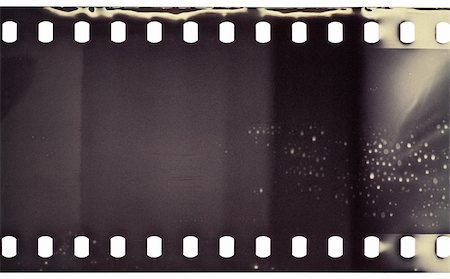 film strip - Blank grained film strip texture Stock Photo - Budget Royalty-Free & Subscription, Code: 400-05691075