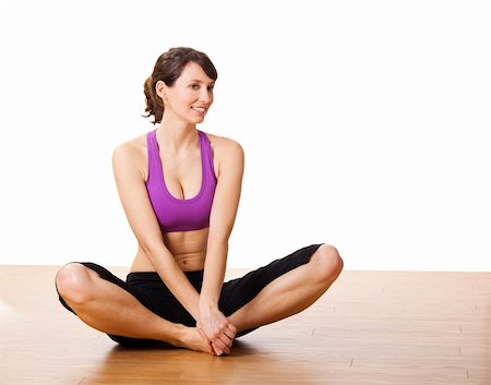 Beautiful and athletic young woman doing yoga exercises Stock Photo - Budget Royalty-Free & Subscription, Code: 400-05705004
