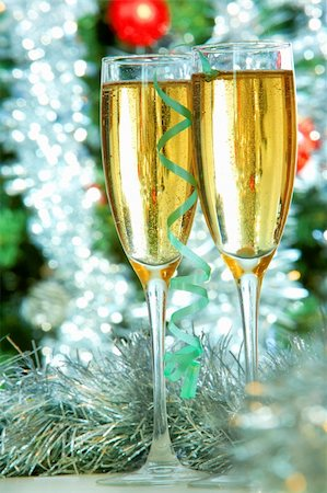simsearch:400-05749231,k - Two champagne flutes on Christmas background Stock Photo - Budget Royalty-Free & Subscription, Code: 400-05705286