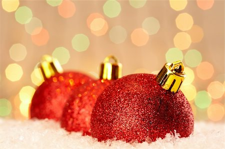 simsearch:400-05749231,k - Red glittering Christmas baubles against glaring background Stock Photo - Budget Royalty-Free & Subscription, Code: 400-05707113