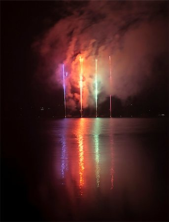 Colorful fireworks on black sky background with water reflections Stock Photo - Budget Royalty-Free & Subscription, Code: 400-05708154