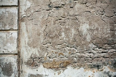 Detail of an old cracked cement walll texture Stock Photo - Budget Royalty-Free & Subscription, Code: 400-05700942