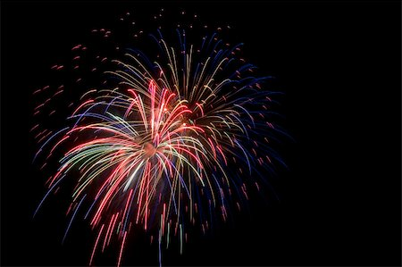 Colorful fireworks isolated over a dark background Stock Photo - Budget Royalty-Free & Subscription, Code: 400-05701008