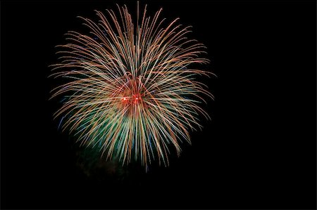 Colorful fireworks isolated over a dark background Stock Photo - Budget Royalty-Free & Subscription, Code: 400-05701009