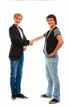 Two teenage boys shaking hands. Isolated on white Stock Photo - Budget Royalty-Free & Subscription, Code: 400-05703085