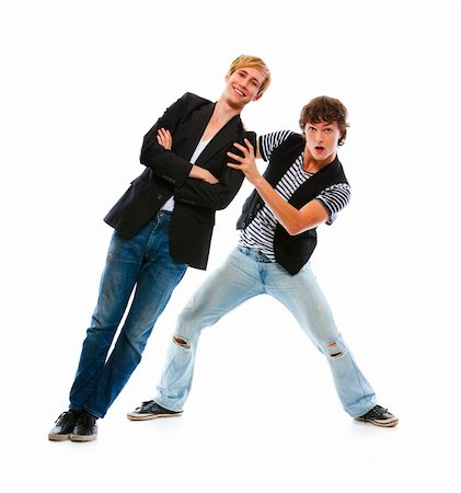 Two modern teenage boys having fun. Isolated on white Stock Photo - Budget Royalty-Free & Subscription, Code: 400-05703086
