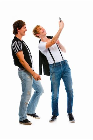 Two modern teenage boys making photos on cell phone. Isolated on white Stock Photo - Budget Royalty-Free & Subscription, Code: 400-05703092
