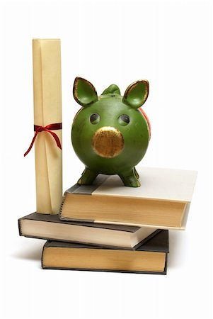education loan - An isolated pig bank and diploma scroll represent educational finances. Stock Photo - Budget Royalty-Free & Subscription, Code: 400-05703116