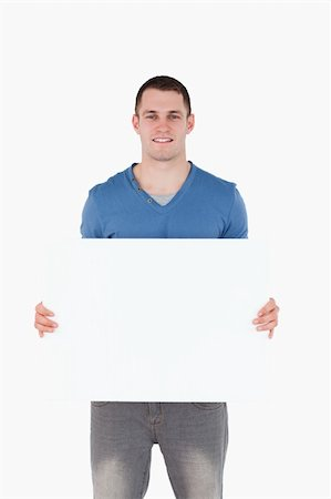 Portrait of a man holding a blank panel against a white background Stock Photo - Budget Royalty-Free & Subscription, Code: 400-05715304