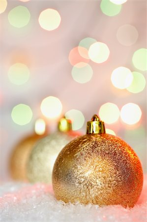 simsearch:400-05749231,k - Golden Christmas baubles against glaring background Stock Photo - Budget Royalty-Free & Subscription, Code: 400-05715987